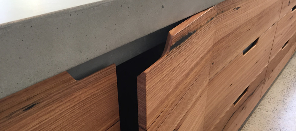 Concrete Kitchen Bench with Timber Cabinetry
