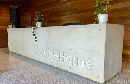Melbourne - Raine and Horne Concrete Reception Desk