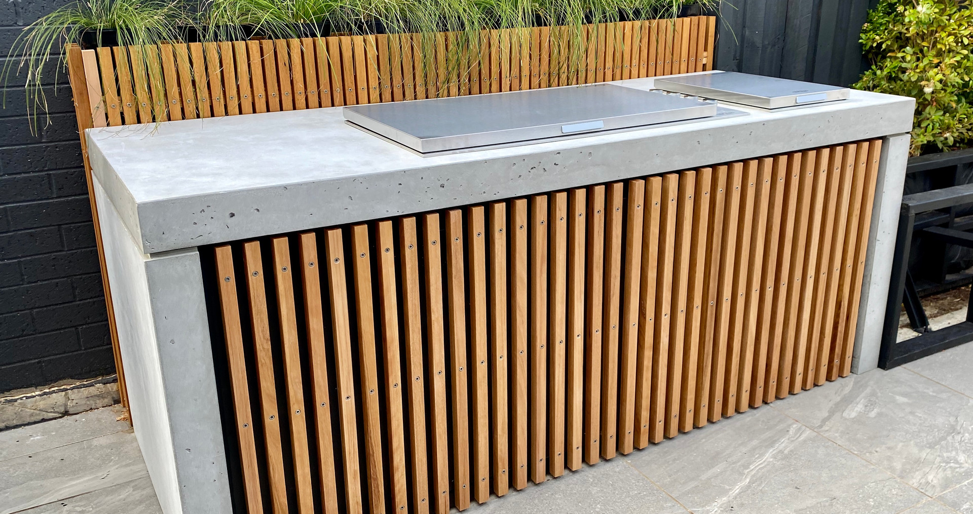 Outdoor Concrete Kitchen with Timber Battens in Torquay