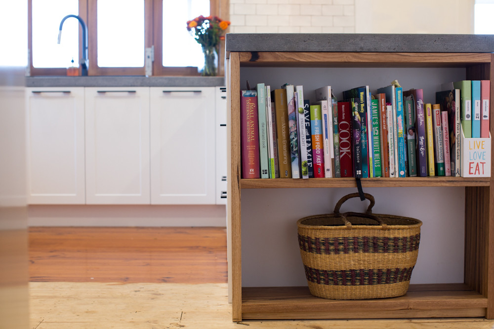 Concrete Benchtop with a Timber Bookcase
