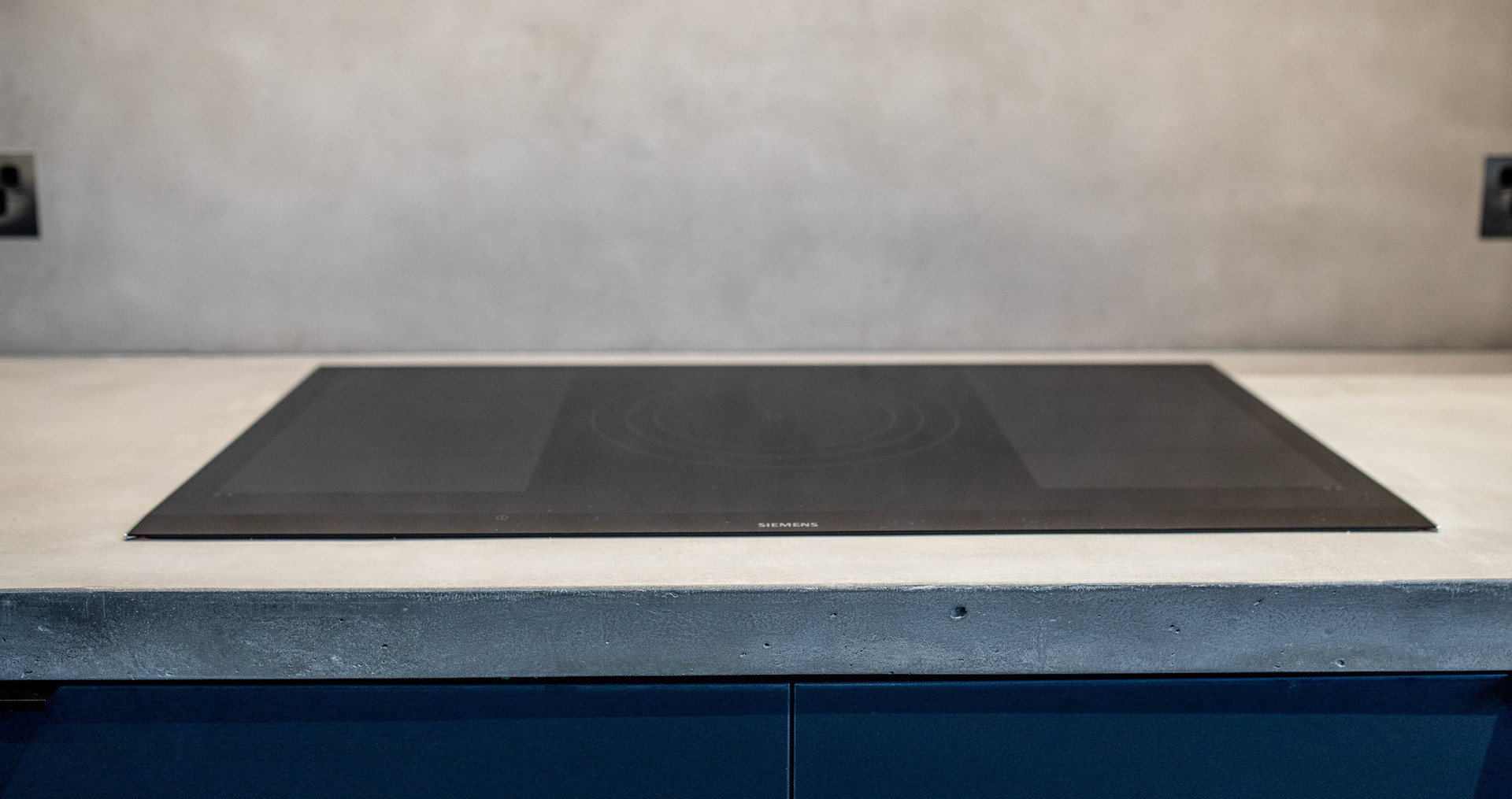 Concrete Cooktop Bench and Concrete Splashback