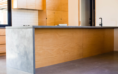 Concrete Benchtops with Plywood Cabinetry Design