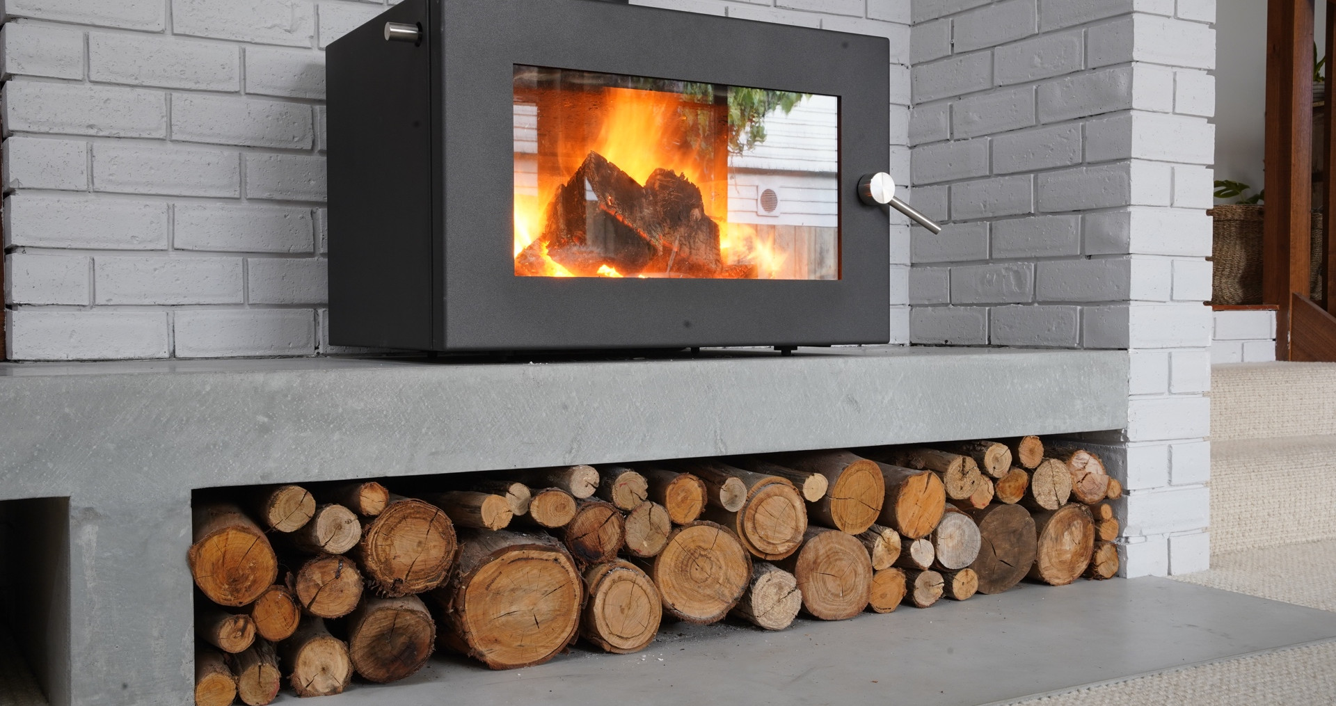 Concrete Fire Hearth with Wood Storage