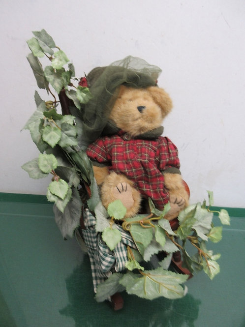 Boyds Bear sitting in a small wood rocking chair with ivy accent