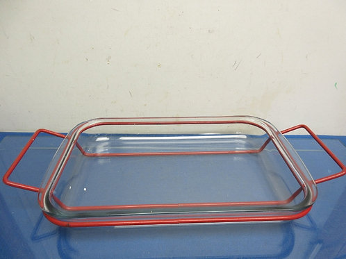 Glass baking dish with red metal serving caddy 9x13