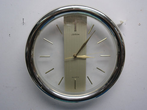 "Sunbeam quartz wall clock, gold and clear, 12"" diameter"