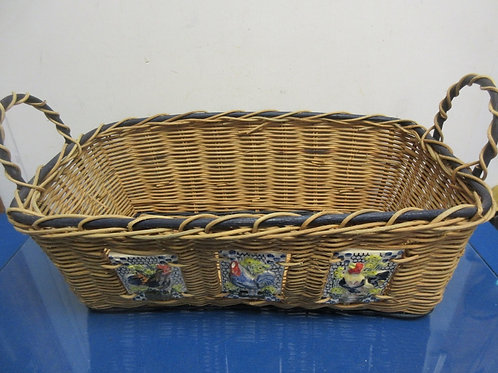 Rectangular wicker basket with 3 rooster accents on side also has 2 handles