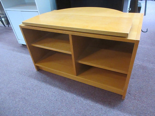 Ikea swivel top light tone TV stand with bottom cubby shelves