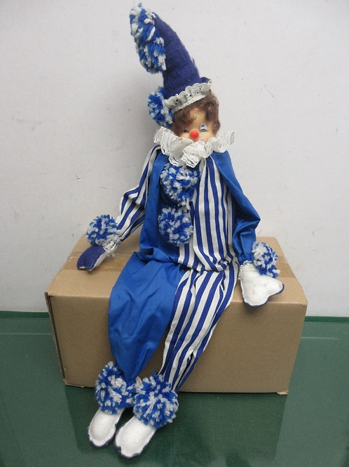 Clown in blue outfit that sits on shelf - use it like his cousin, elf on a shelf