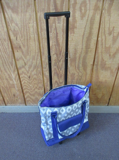 Purple,gray, and white heavy vinyl insulated cooler on wheels, pull along handle