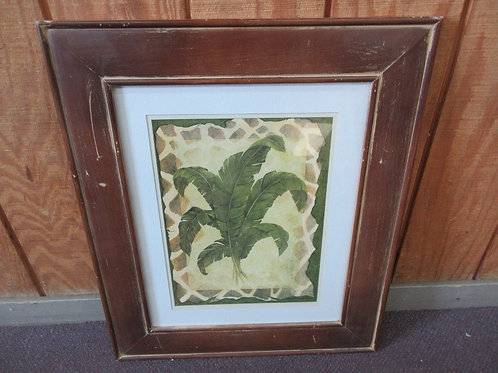 Print of banana leaves with animal skin design mat & distressed brown frame