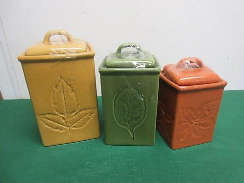 Set of LillianVernon ceramic leaf design canisters, 3 in graduated sizes