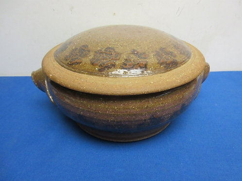 Large brown pottery bowl with lid