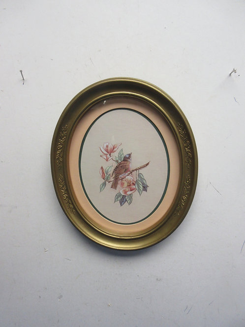 Oval gold framed print of bird and flowered branch