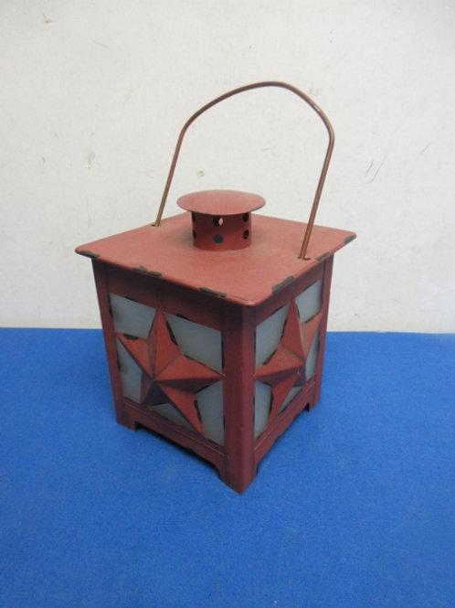 Distressed red metal candle lantern