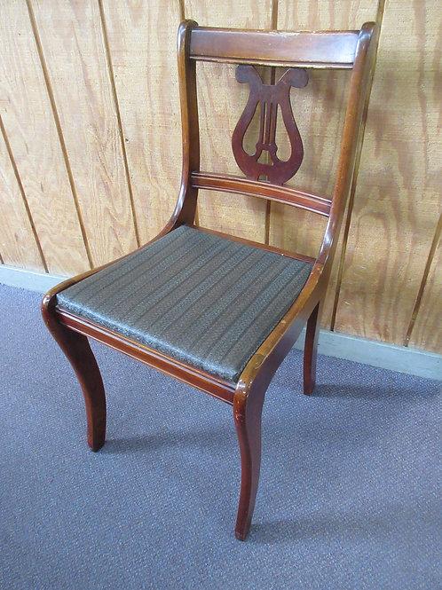 Antique harp back accent chair