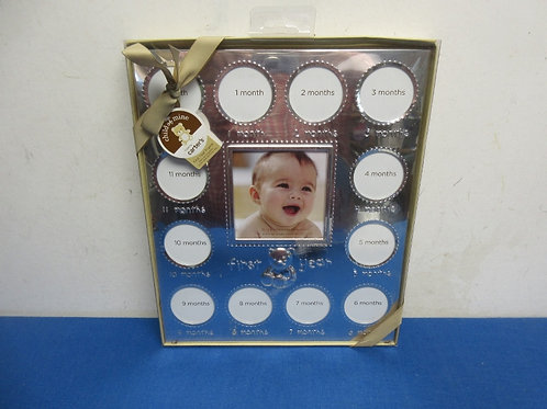 Silver baby frame has monthly picture slots for the first year - to watch baby g