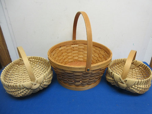 Set of 3 light colored baskets with handles
