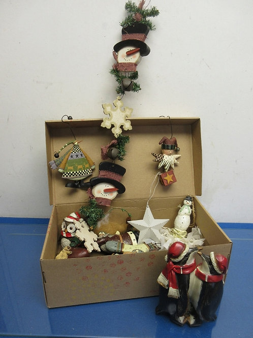 Shoe box filled with wood and resin snowmen, penguins, and more...