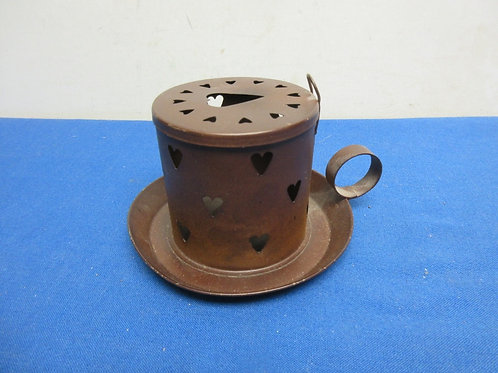 Metal hand made brown candle holder with single loop finger handle