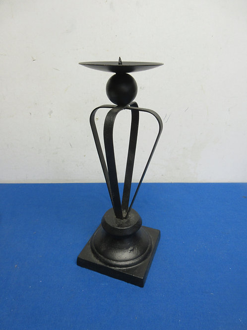 Black metal pillar candle stand