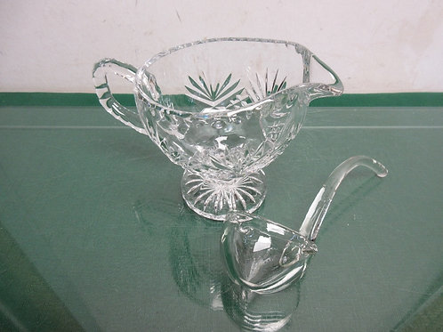 Cut glass footed gravy boat with glass ladel