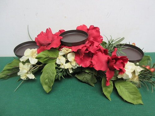 "Artificial floral center piece with 3 pillar candle platforms, 18""long"