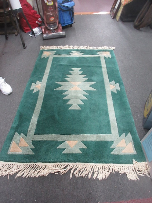 Green heavy 100% wool area rug with fringe - 42x65