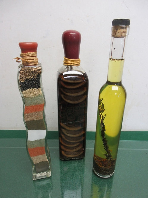 Set of 3 decorative tall skinny bottles with spices & preserved fruit