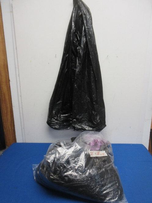 "Bag of over 250 black trash bags, 23""x28"" long"
