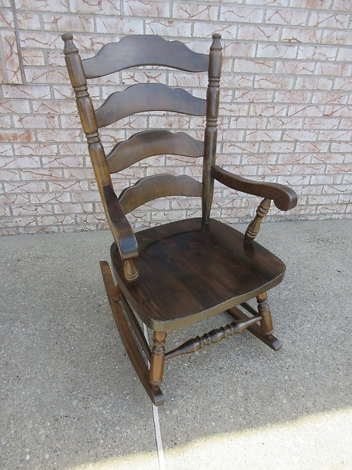 Dark heavy slat back rocking chair with arms