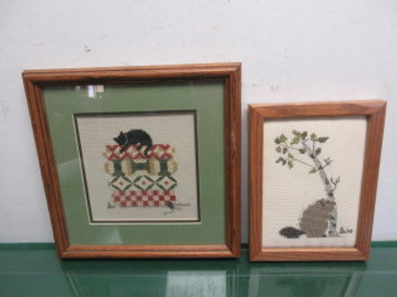 Pair of mall framed animal needlepoints,  cat & a beaver