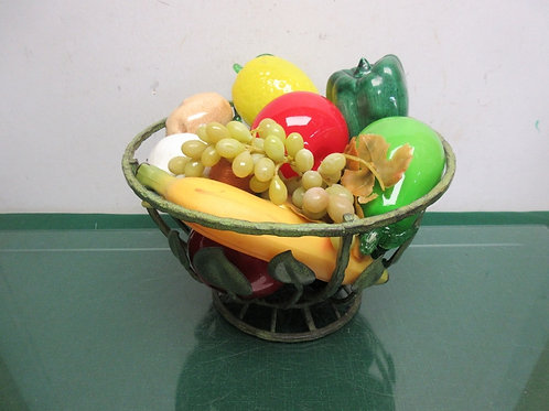 Green metal open design bowl filled w/plastic & glass fruit & vegetables