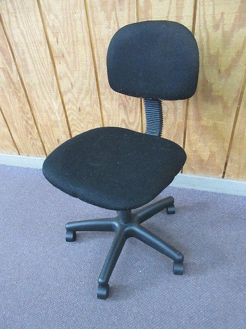 Black fabric office chair on wheels