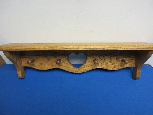 Oak shelf with coat pegs and heart cutout