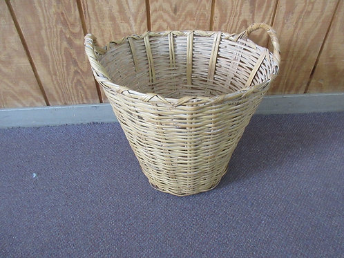 Vintage tall wicker laundry basket with handles