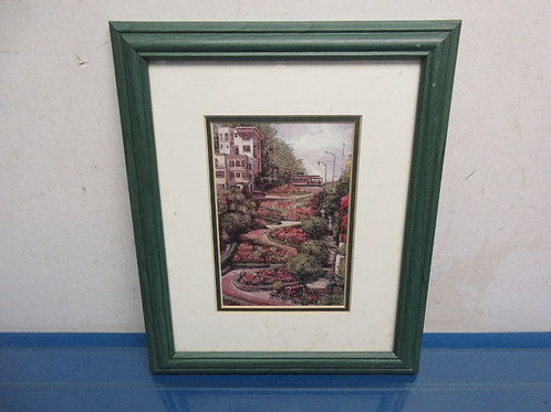 Picture of winding garden with trolley in background, green wood frame 9x12""