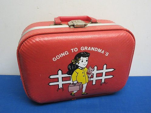 """Vintage small red suitcase """" going to grandmas"""" printed on the side"""