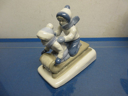 """Porcelain statue of 2 boys riding a sled-6x6"""""""