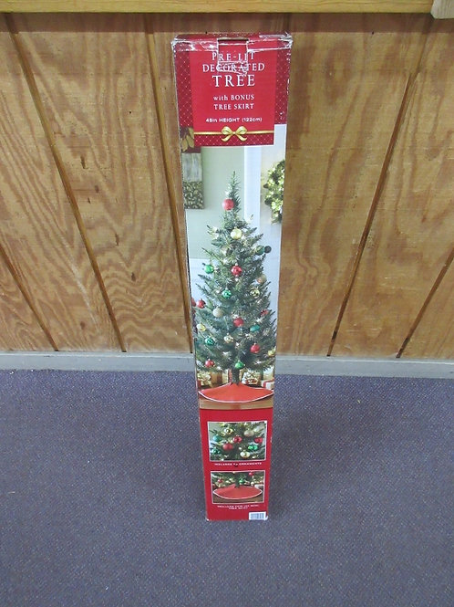 "Pre-lit decorated tree with skirt and 18 ornaments, 48"" high"