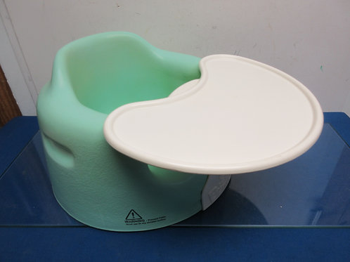 Green and ivory bumbo baby chair with snap tray