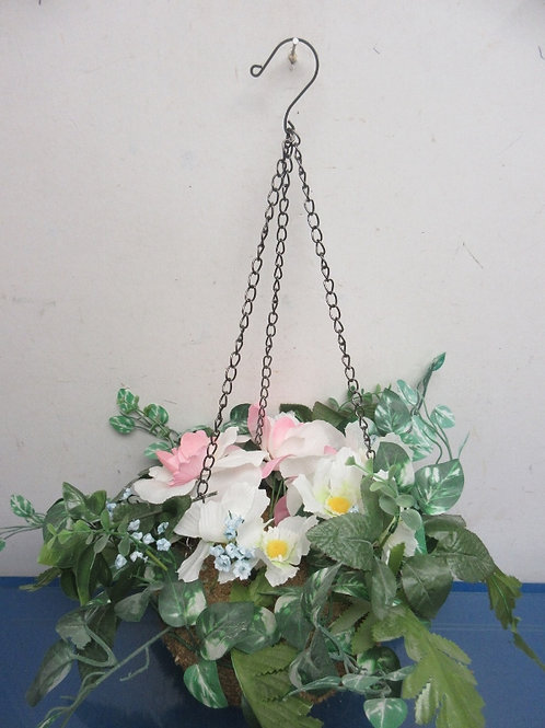 Small floral arrangement with hanging chain