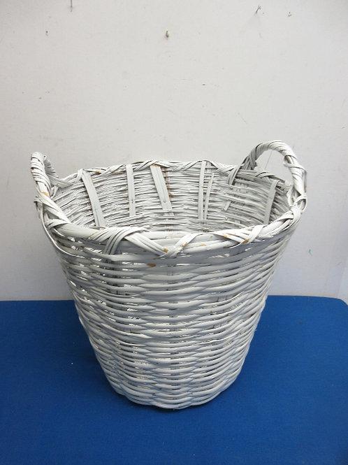 White woven round laundry basket