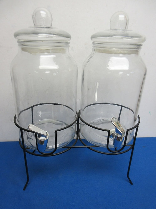 Double glass drink dispensers on black metal stand