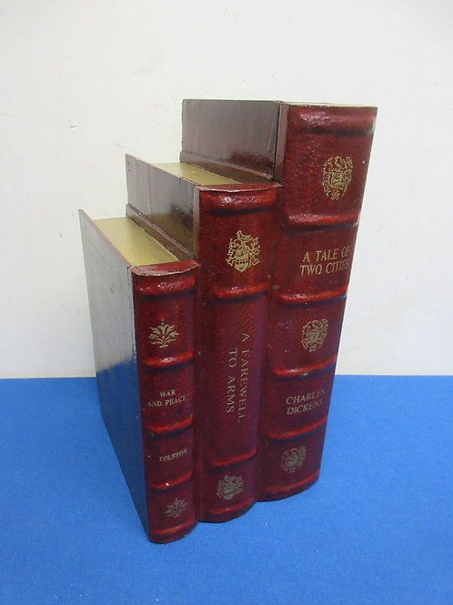 Faux stack of red vintage books with secret door for storage inside