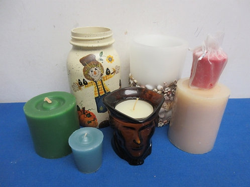 Small box of assorted candles and candle holders