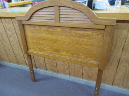 Twin size medium tone wooden head board
