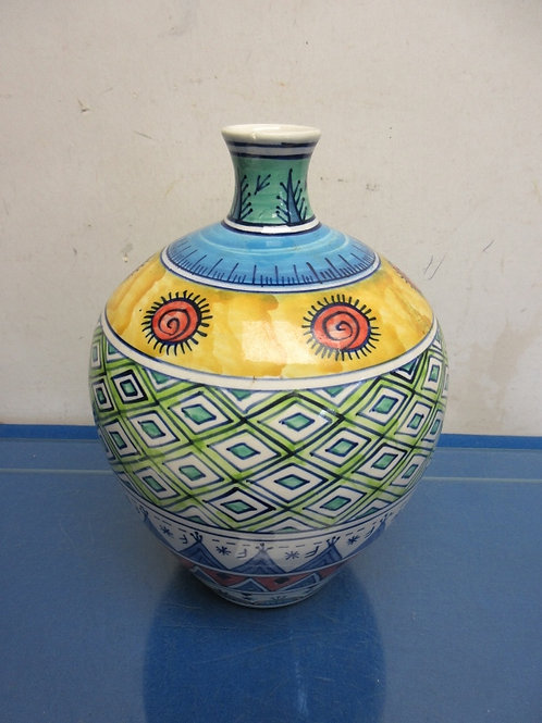 Multi colored Native American jar vase with narrow top opening