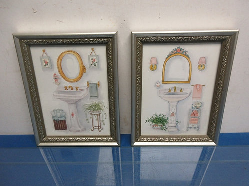 Pair of prints, bathroom sinks and accessories, each in silver frames 7x9""