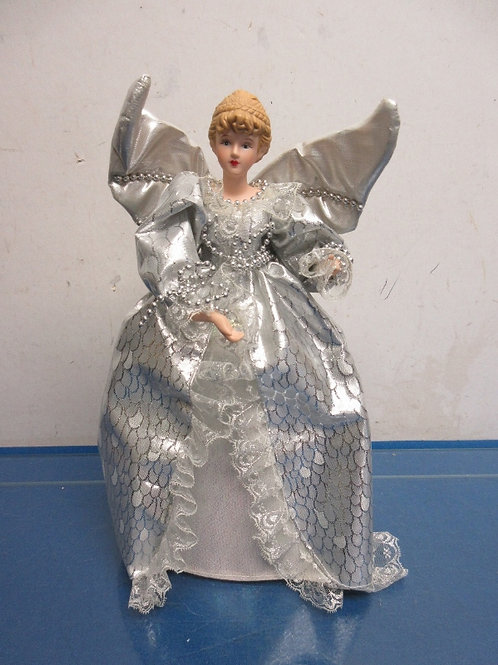 Angel tree topper with silver dress